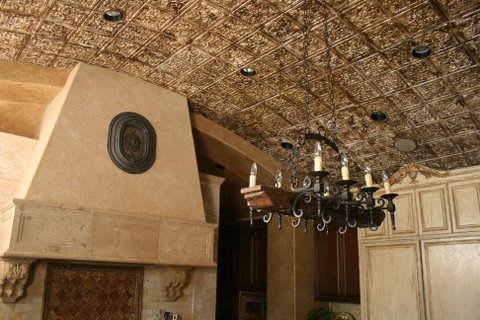 fireplace,chandelier and a crusty looking barell ceiling
