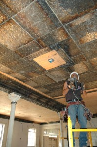 Original tin ceiling tiles go back up -- photo from nps.gov