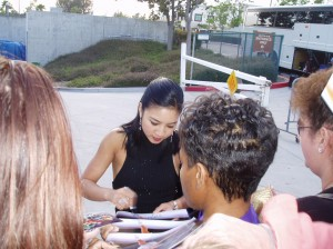 Michelle Kwan signs autographs for fans—courtesy of Marge Packman