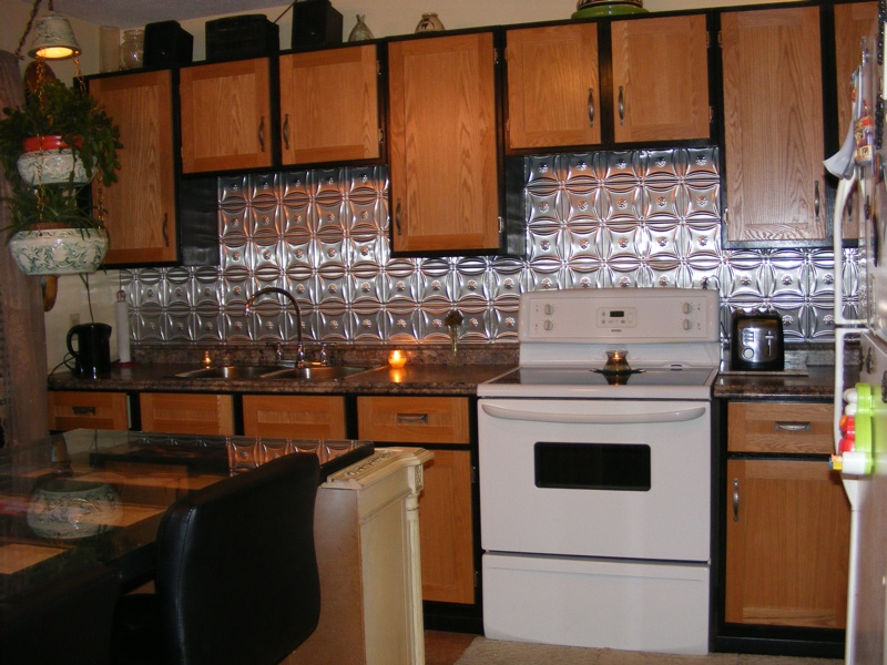 Kitchen with Metal Backsplash by The Bulls